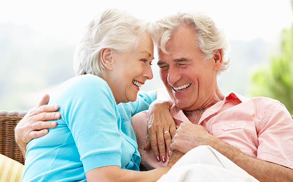 Older couple with younger couple smiling
